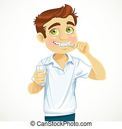 Cute man with a glass of water brushing his teeth isolated on white background