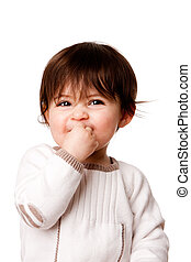 Face of a cute adorable baby infant toddler with innocent mischievous naughty expression, isolated.