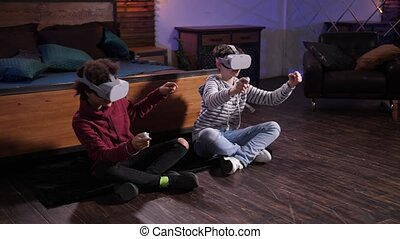 Cute mixed race friends racing cars in VR goggles