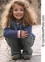 cute model - little girl posing for the camera