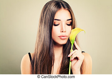 Cute Model Woman with Healthy Skin and Flowers on Background. Young Beauty, Facial Treatment and Cosmetology Concept