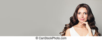 Cute model woman with long curly hair on banner background