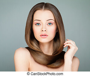 Cute Model Woman with Long Hair. Spa Girl with Healthy Hairstyle. Beauty Salon or Barber Shop Background