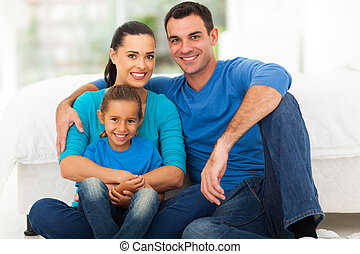 cute modern family sitting at home