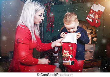 6072606abdb22 Family celebration concept. christmas woman with cute baby ...