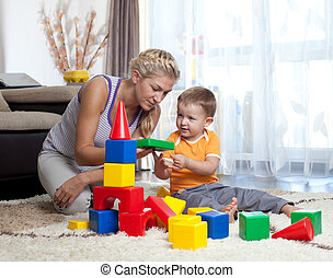 cute mother and child boy playing together indoor - cute...