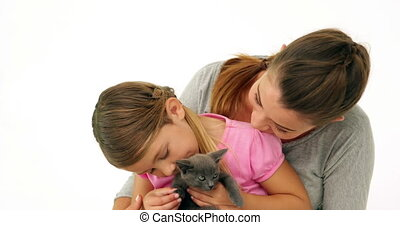 Cute mother and daughter with a kitten