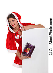 Cute Ms Santa with a gift and a board left blank for your message