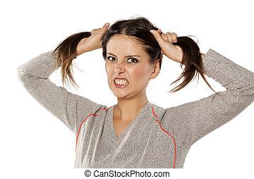 cute, mulher, dela, zangado, dois, cabelo, caudas, segurando