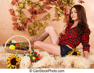 cute, mulher jovem, sentando, em, um, feno