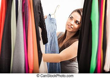cute, mulher olha, em, dela, armário