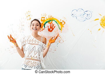 cute, mulher, parede, jovem, alegre, mãos, branca, quadro