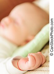Cute newborn baby sleeping in bed