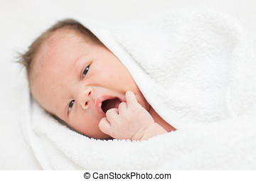 newborn baby with towel