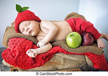 Cute newborn child sleeping on a soft blanket