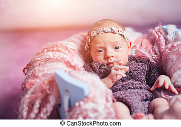 cute newborn girl looking at camera