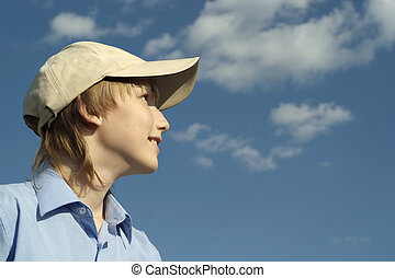 Cute nice boy posing outdoors