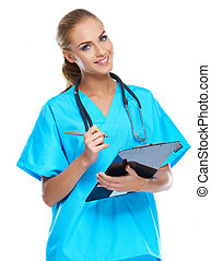 Cute nurse looking at the camera and smiling with writingpad