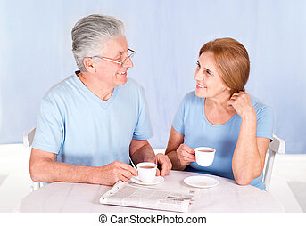 old couple at breakfast