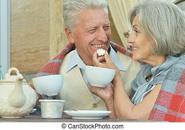 old couple drinking tea