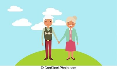 cute older couple holding hands in the park