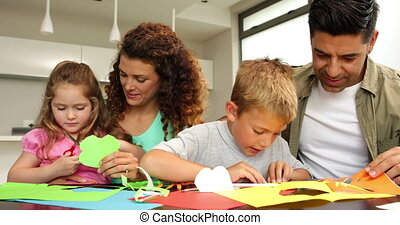 Cute parents and children doing crafts