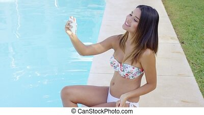 Cute playful young woman posing for a selfie