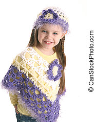 Cute preschool girl wearing handmade clothes