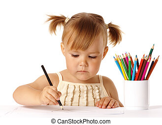 Cute preschooler focused on drawing, isolated over white