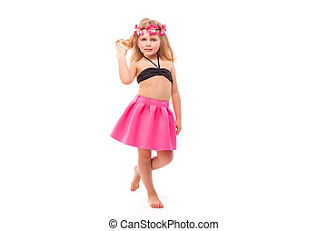 Cute pretty little girl in black bikini, pink skirt and pink wreath