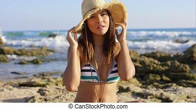 Cute pretty young woman in a bikini