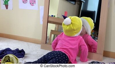 Cute princess girl with yellow hat kissing herself in a...