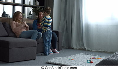 Happy family with child relaxing in domestic room