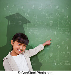 Cute pupil with graduate shadow - Composite image of cute...