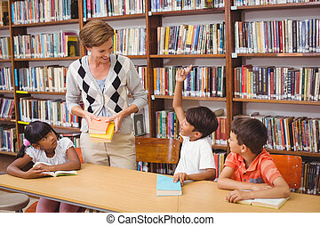 Cute pupils and teacher reading