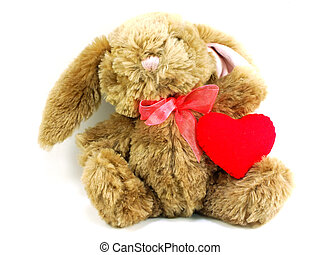 cute rabbit doll with red heart on white background