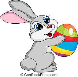 Cute rabbit holding ester egg
