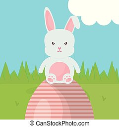 cute rabbit with easter egg painted in the camp