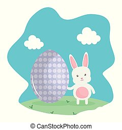 cute rabbit with easter egg painted in the landscape