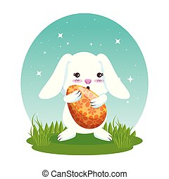 cute rabbit with easter egg painted in the meadow
