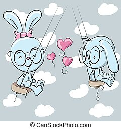 Cute rabbits on the swing