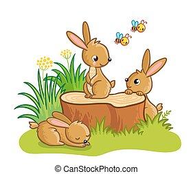 Cute rabbits sitting around the stump.