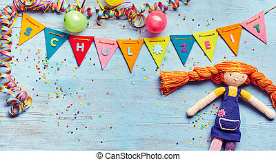 Cute rag doll on a Schul Zeit German background with...