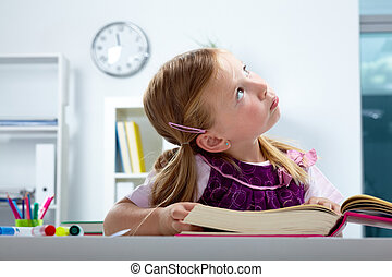Cute reader - Portrait of lovely girl looking aside while...