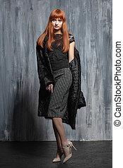 Cute redhead woman posing in studio