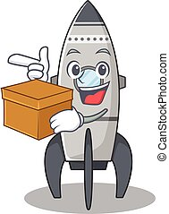 Cute rocket cartoon character having a box
