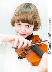 Cute school boy playing violin, close up portrait