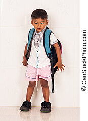 cute school boy with backpack