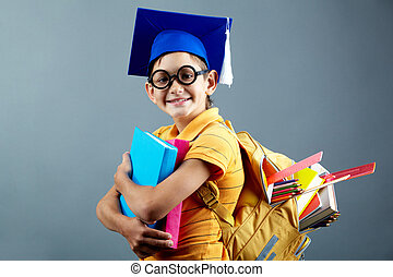 Cute schoolboy - Portrait of happy schoolkid with backpack...