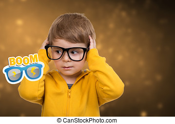 Cute schoolboy thinking idea while wearing glasses and looking at up, isolated